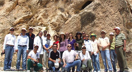 group photo in front of rock formation